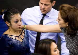 Senior gymnast Vanessa Zamarripa holds back tears as she is comforted by coach Valorie Kondos Field after scoring a 9.100 on vault, the final event for the Bruins in Saturday's NCAA team championships. The team placed fourth behind Florida, Oklahoma and Alabama despite an early lead.