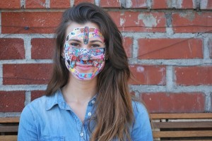 UCLA alumna Maria Springer, co-founder of LivelyHoods, wears Band-Aids on her face as part of a fundraising campaign.