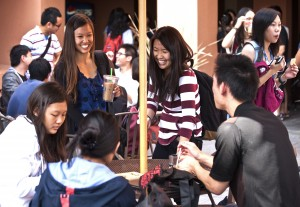 International and domestic students talk and drink coffee and tea during the World Cafe event held by the Dashew Center for International Students and Scholars in October.