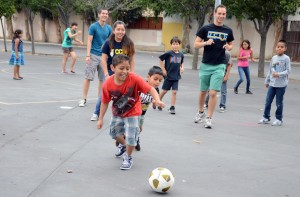 UCLA students from Amigos de UCLA, a community service group on campus, play with kids from Pio Pico, a school with many children from low-income backgrounds.