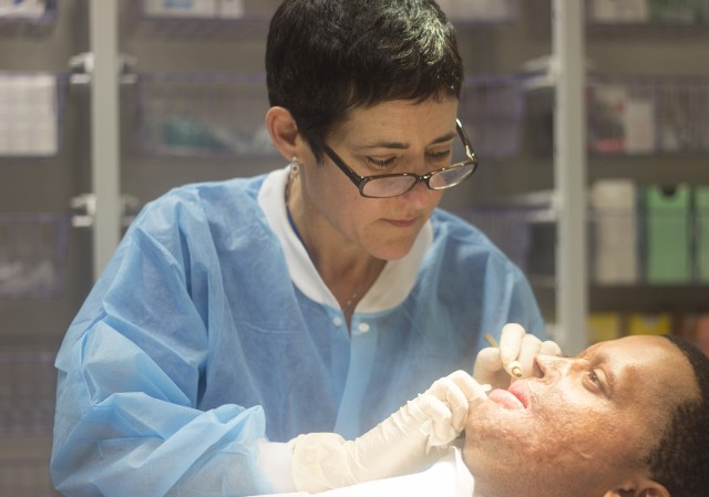 Capt. Jabari White was sitting as a passenger in a vehicle when a bomb detonated, burning 60 percent of his body. He now comes to Ronald Reagan UCLA Medical Center from Washington, D.C. for tattooing to blend the pigmentation on his face. (Felicia Ramirez/Daily Bruin staff)