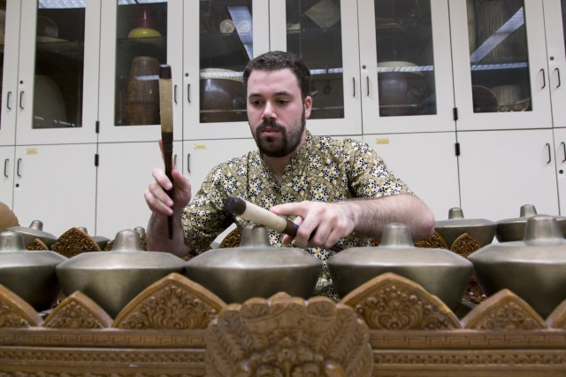 UCLA ethnomusicology graduate student Tyler Yamin plays the instruments of a gamelan ensemble, including the trompong (above) and kendang. (Owen Emerson/Daily Bruin senior staff)