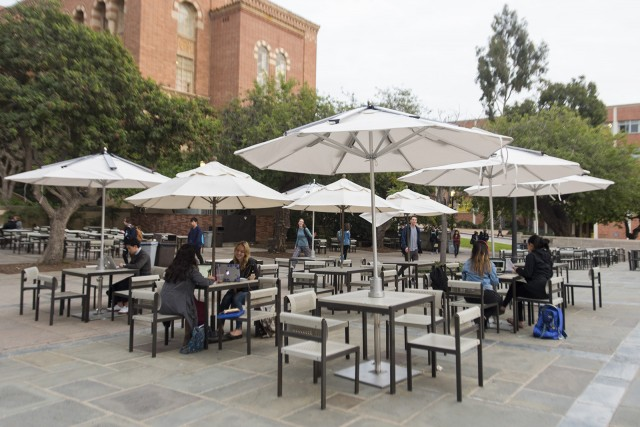 The USAC Facilities Commission and ASUCLA added five solar umbrellas with charging stations on Kerckhoff patio Wednesday. (Miriam Bribiesca/Photo editor)