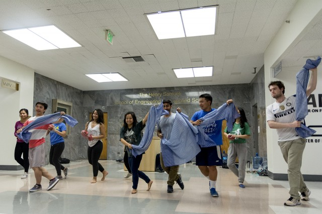 "Club members of United Khmer Students of UCLA rehearse for their play ""Lost in Translation"" for this year's Cambodian Culture Night. ""Lost in Translation"" is based on the effects of the Cambodian genocide in the 1970s. (Eileen Lising/Daily Bruin)"