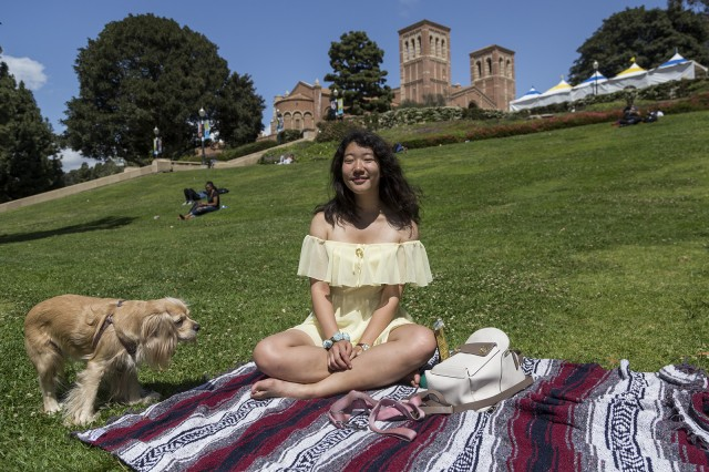 Third-year microbiology, immunology and molecular genetics student Annie Gao was drawn to the bright yellow color of an off-the-shoulder dress at Forever 21. She decided to buy the dress, despite her typical preference of shorts and T-shirts. (Alyssa Dorn/Daily Bruin staff)
