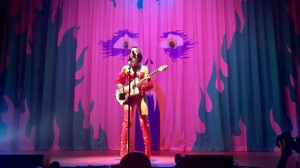 "St. Vincent performed a slower song ""Strange Mercy"" in front of a fanged cartoon backdrop before introducing songs from her new album ""MASSEDUCTION.""  (Alexandra Del Rosario/Daily Bruin)"
