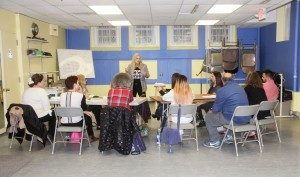 Alumna Katie Torpey teaches a screenwriting class at the Ridgefield Playhouse in Connecticut. The class aims to teach students how to transform their personal life stories into cohesive film projects. (courtesy of Katie Torpey)