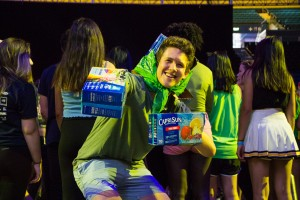 Austin Newton, a third-year business economics student, wore cut-up boxes of Capri Sun over his head and his hands at Dance Marathon 2018. Newton is the mascot for Team Green, which took third place at the Color Wars fashion show. (Emma Skinner/Daily Bruin)