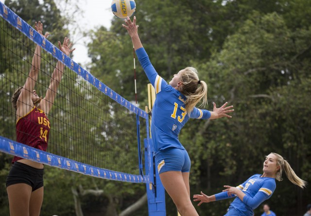 Juniors Nicole McNamara and Megan McNamara clinched the Bruins' win over Stanford on Friday in the Pac-12 championships. (Keila Mayberry/Daily Bruin staff)