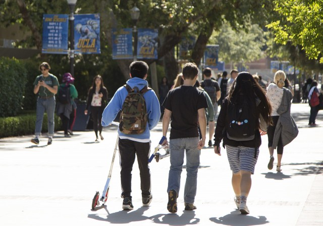 Bird and LimeBike scooters have become a mainstay on campus. But dismount zone rules continue to be broken, and UCLA seems to think the problem is because students don't know about policies. Rather, noncompliance is because of lack of incentives for riders. (Amy Dixon/Assistant Photo editor)