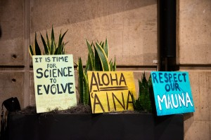 Students made signs to oppose the construction of a 30-meter telescope on a sacred Hawaiian burial site at a town hall Monday. The Pacific Islands' Student Association organized the town hall to discuss the controversy surrounding the University of California's involvement in the construction of the telescope.(Tanmay Shankar/Daily Bruin)