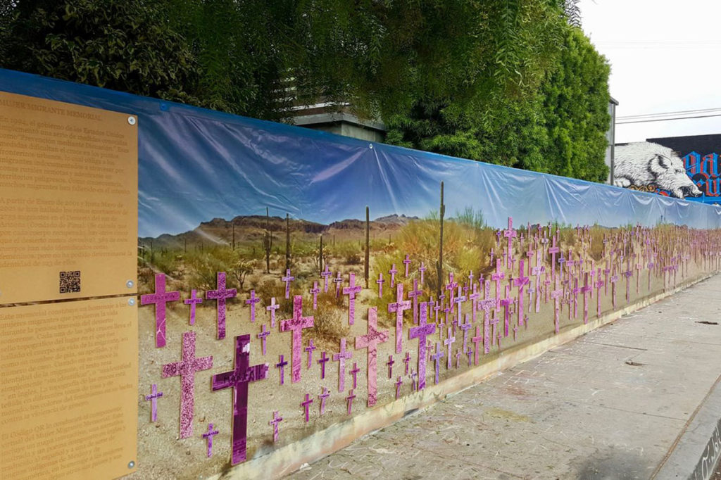 The Mujer Migrante Memorial mural can be found in Venice, CA, with named and unidentified crosses in shades of pink and purple that are joined by two panels of information. (Courtesy of Filomena Cruz)