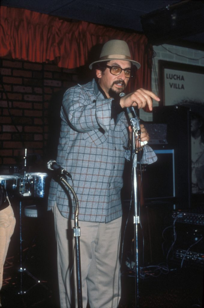 """José Montoya performing at a """"One More Canto"""" poetry reading at the Reno Club in Sacramento, February 27, 1979. Montoya was a poet and artist known as a leader in establishing Chicano culture and"""