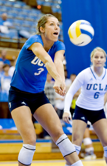 Redshirt senior opposite Kaitlin Sather (left) digs a ball of a kill from USC's powerful offense. Sather was second on the Bruins with 15 digs while sophomore libero Lainey Gera led both teams with 23.