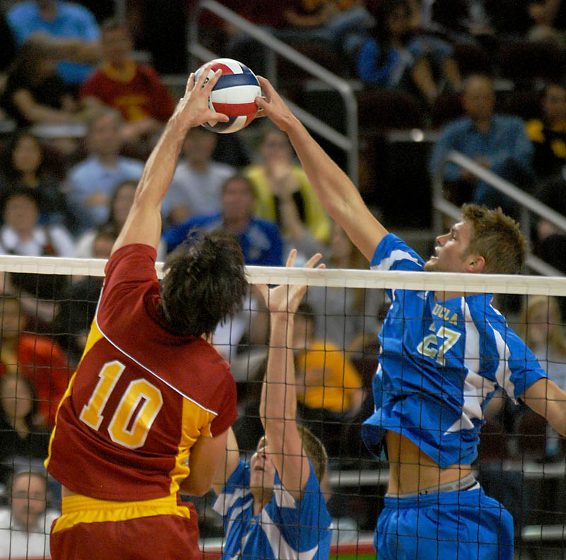 Redshirt sophomore outside hitter Ryal Jagd blocks a spike from USC's setter Riley McKibbin during the Bruins' 3-0 loss at USC's Galen Center. The Bruins enter the MPSF Tournament as the No. 7 seed, one below the Trojans.