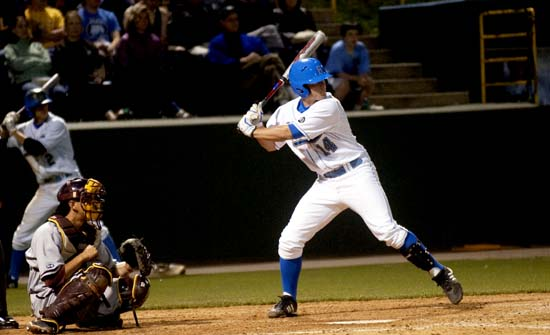 Sophomore infielder Dean Espy (right) and the No. 7 UCLA baseball team will visit No. 8 Cal State Fullerton tonight in their final midweek game of the season.