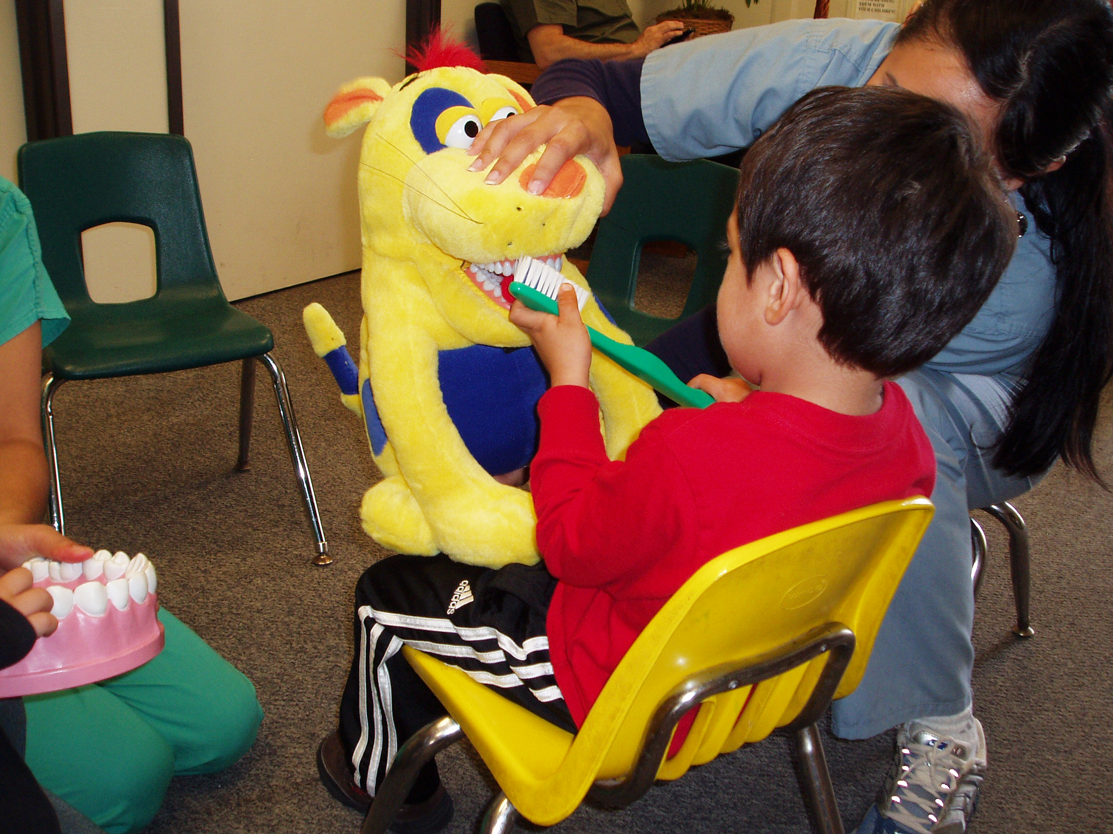 Residents From The Community Health And Advocacy Training Pediatric  Dentistry Program Treat Children At A