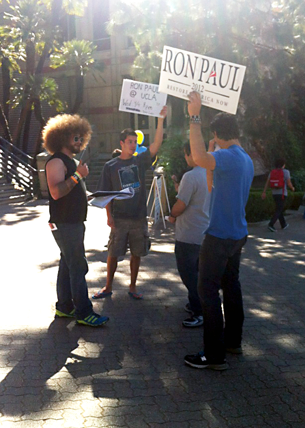 Members of Youth for Ron Paul at UCLA advertise the candidate speaking on campus.
