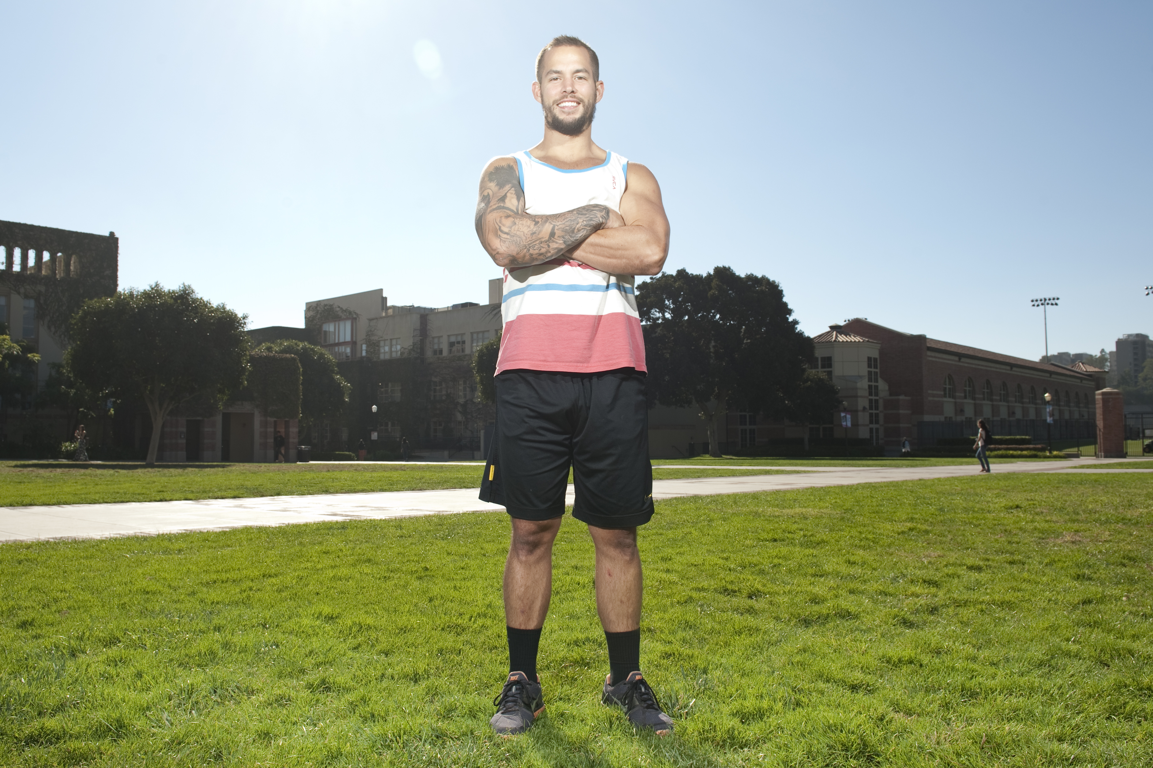 Third-year communication studies student Charles Young served for six years in the Marine Corps before coming to UCLA and playing for the Club Rugby team. His sleeve of tattoos helped him cope with his two deployments.