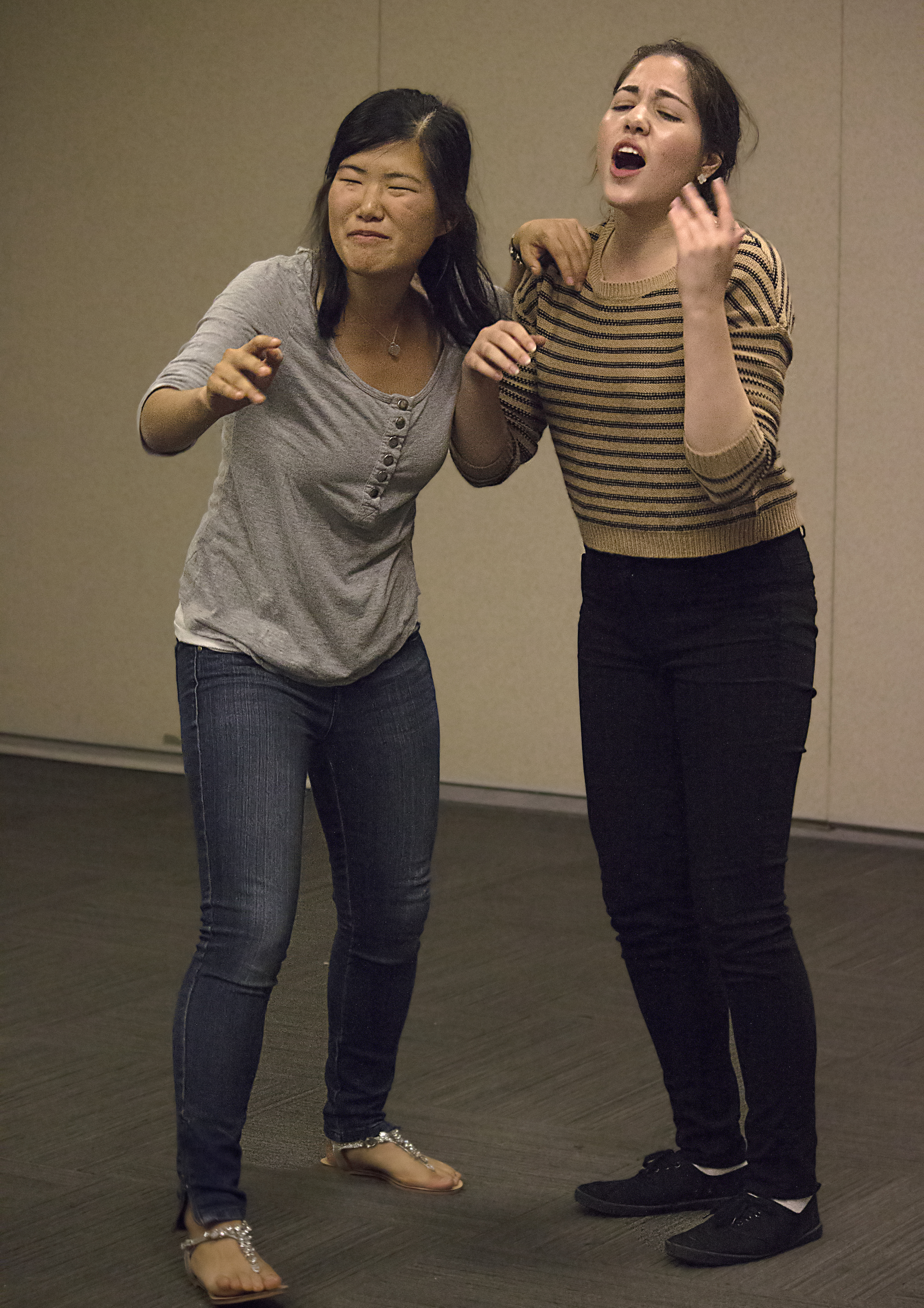 Fourth-year microbiology, immunology and molecular genetics student Grace Lau and fourth-year political science student Yalda Mostajeran practice improv as members of the LCC Theatre Company.