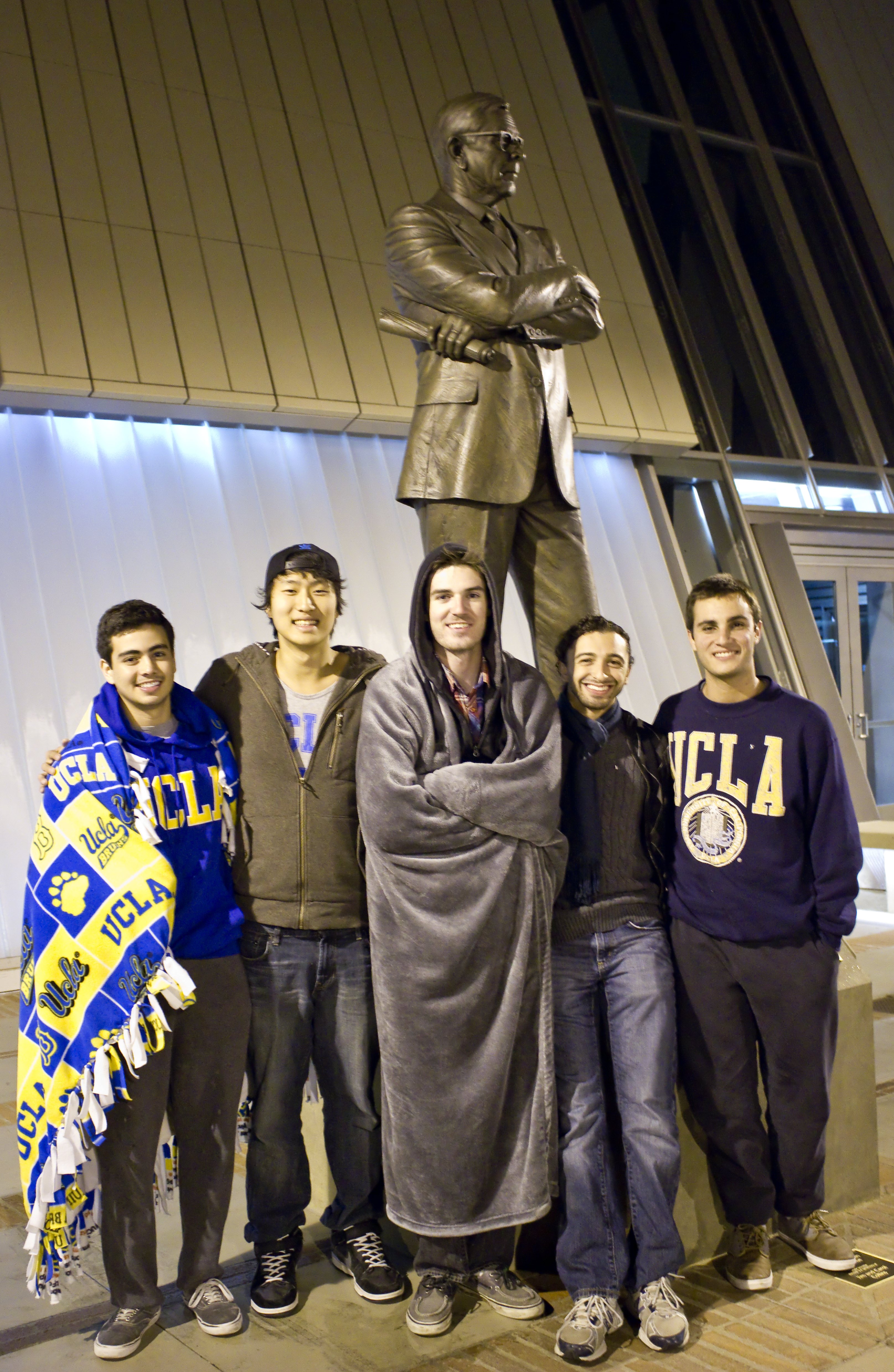 UCLA students stay out all night in front of the John Wooden statue outside Pauley Pavilion to ward of potential USC pranksters during the week leading up to the annual UCLA-USC football game.