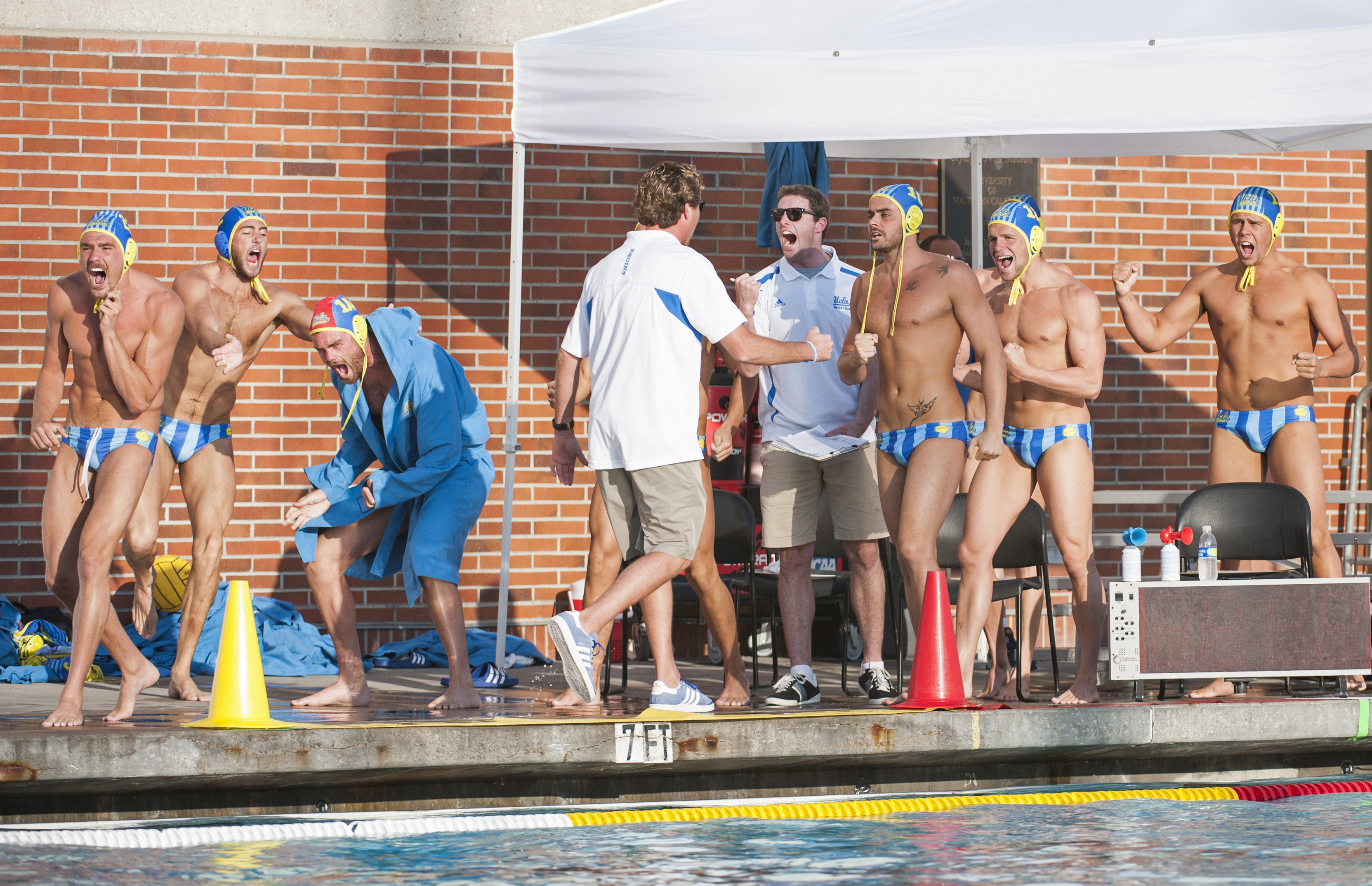 The UCLA men's water polo team celebrates following a sudden death overtime victory over No. 4 Stanford. Sophomore attacker Daniel Lenhart scored the game-winner on the Bruins' first possession of the period. UCLA will also receive an at-large bid to the NCAA tournament thanks to USC's victory over Cal in the MPSF tournament.
