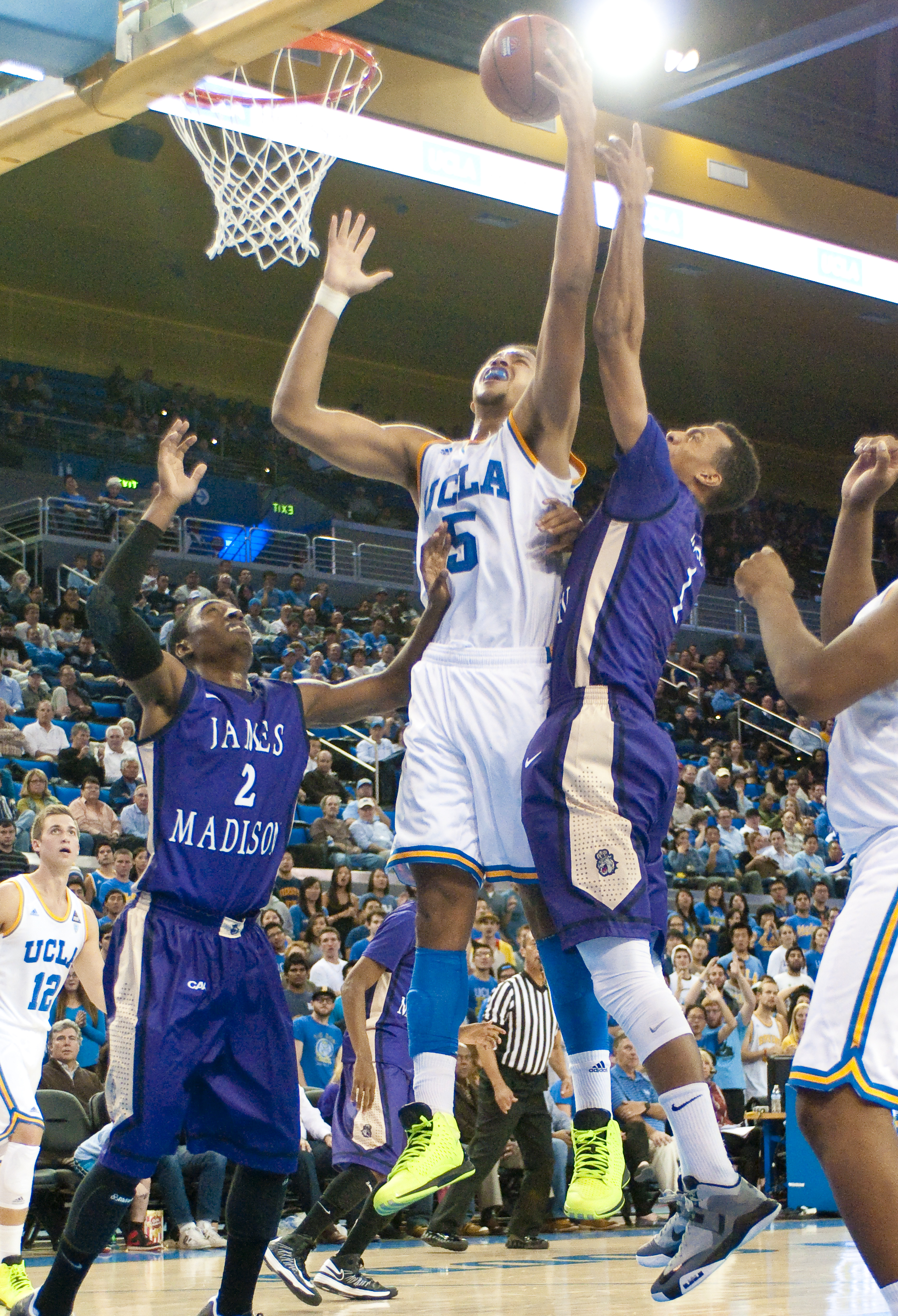 Despite having a height advantage over Cal Poly on Sunday night, the Bruins ended the game tied in total rebounds with the Mustangs. Freshman guard Kyle Anderson, seen here against James Madison, hauled in five of UCLA's 35 rebounds.