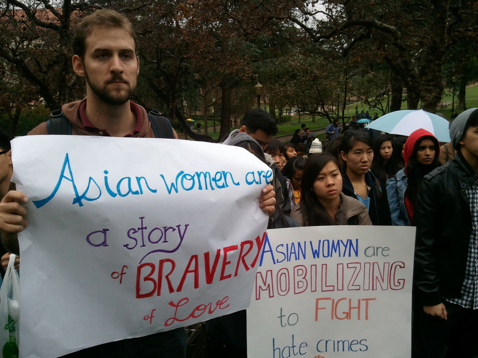 Students gather in front of Kerckhoff Hall Thursday to rally in response to racial and sexist slurs posted in two locations on campus.